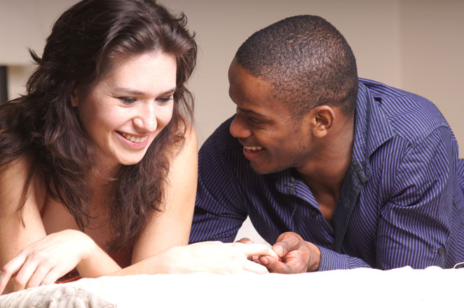 Couple in bed discusses best sex toys for intimacy